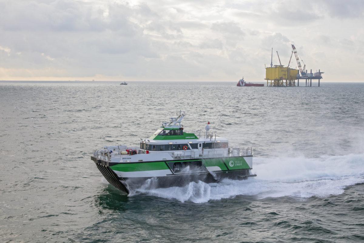 Umoe Rapid fast crew transfer vessel at offshore windfarm